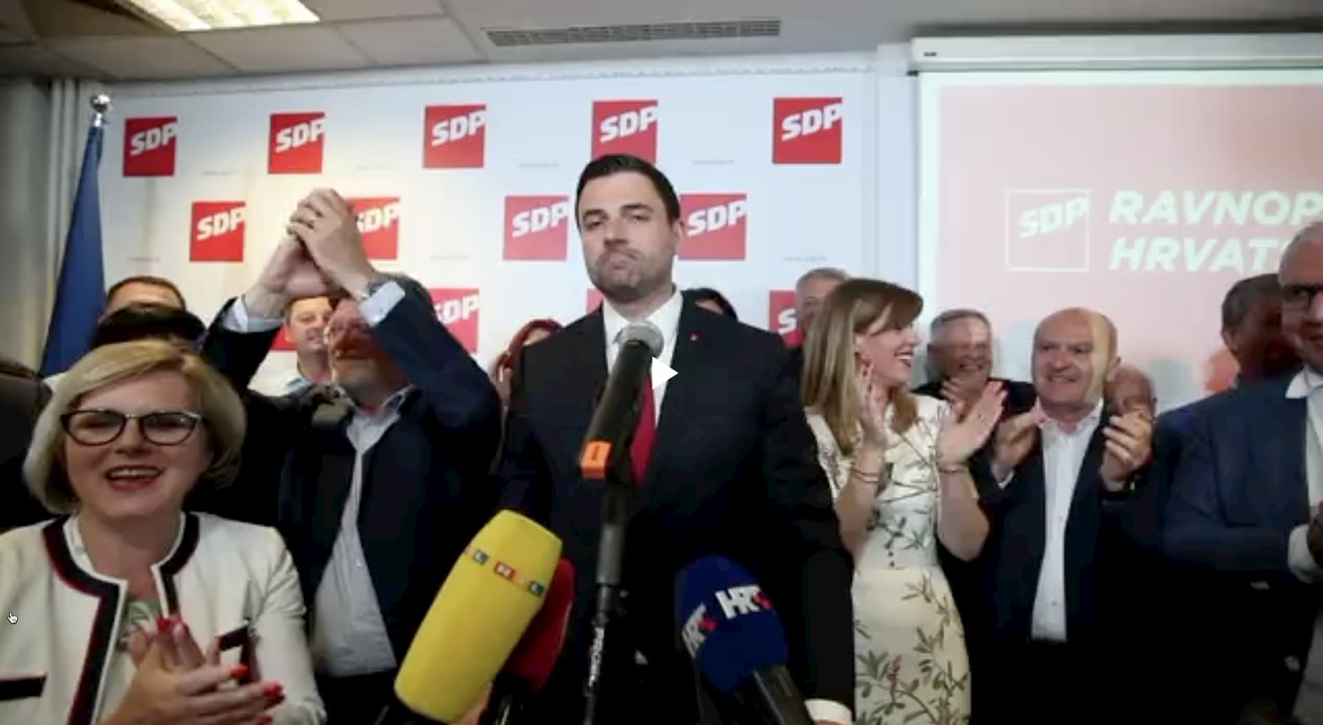 Davor Bernardić, SDP party leader, surrounded by supporters, celebrating good election results for social-democrats. HDZ vs. SDP rundown.